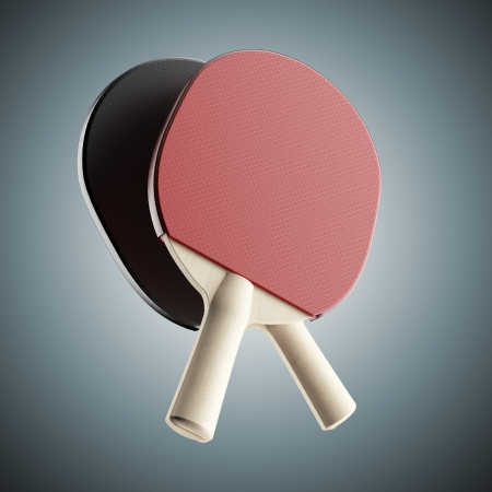ping-pong rackets isolated on blue photo