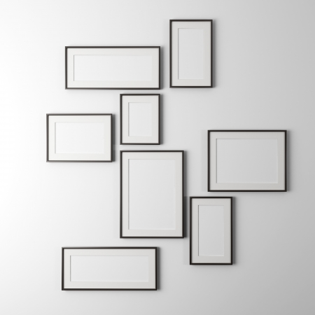 different sized empty photo frames isolated on a white background photo