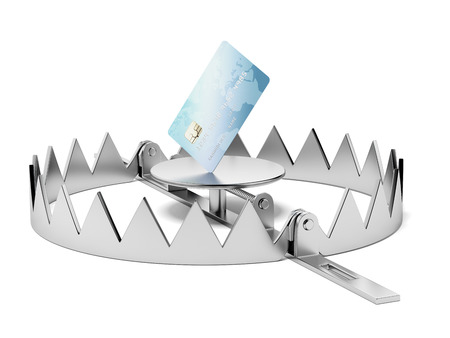 lending: Credit card in the trap isolated on a white background