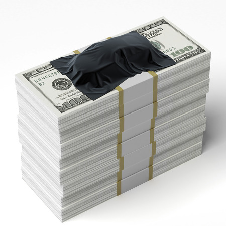 Car under the tissue on the stack of dollars isolated on a white background photo