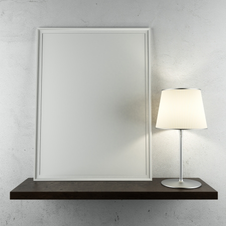 shelf with frame and lamp on the white wall photo