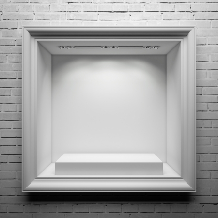 showcase with white stand and frame on the brick wall photo