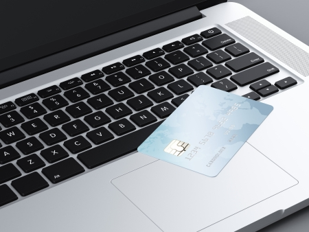 credit card on laptop . 3d render photo