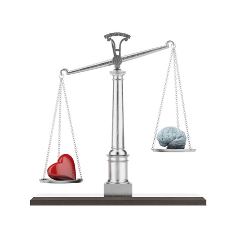 intuition: Scales with brain and heart isolated on a white . 3d render