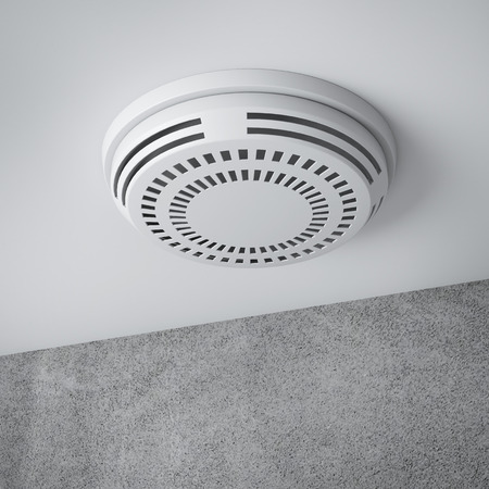 smoke detector on a ceiling isolated on a white background. 3d render photo