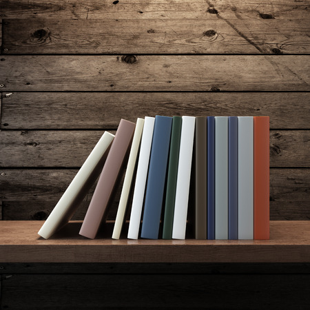 pile of books on wooden shelf. 3d render photo