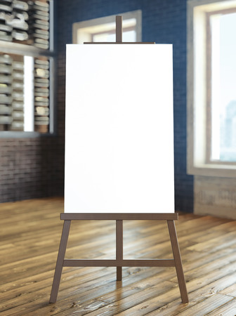 easel with blank canvas in interior