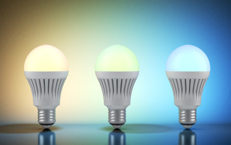 e27: Three multicolor LED bulbs with wireless remote Stock Photo