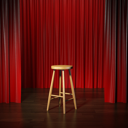 funny people: stool on a stage Stock Photo