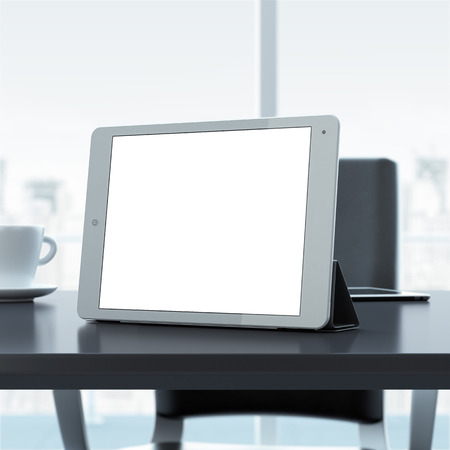 Empty tablet on office table Фото со стока