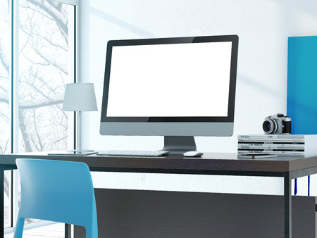 Computer on the table in modern studio with shelves