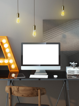 Modern workspace with computer and light bulbs photo