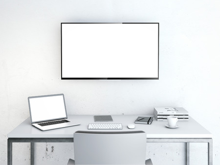 working on computer: Wotkplace with table and large screen on the wall Stock Photo