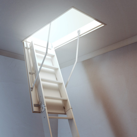 scuttle: wooden ladder to the attic Stock Photo