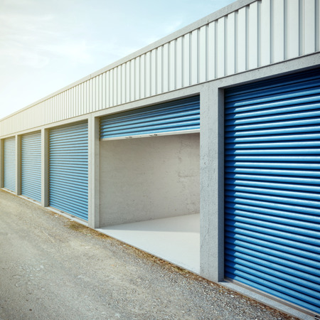 garage door: Empty storage unit with opened door