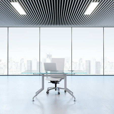 Modern workplace in the office with windows photo