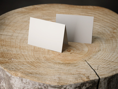 wooden insert: Two business cards on the stump