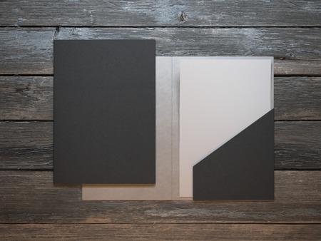 Modern folder on wooden table Zdjęcie Seryjne - 40652344