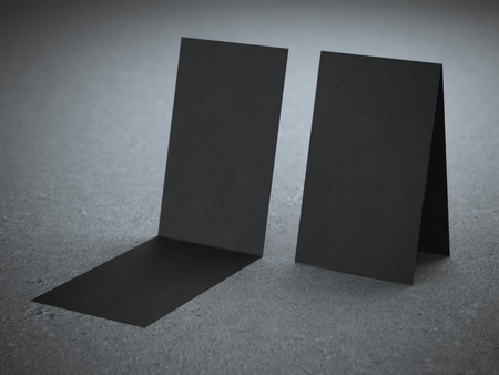Two folded black business cards photo