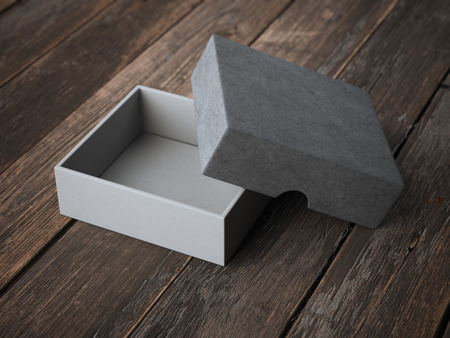 Open gray box on wooden table