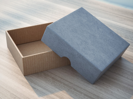 Open box on wooden table Stock Photo