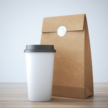 cup: Coffe cup and paper bag Stock Photo