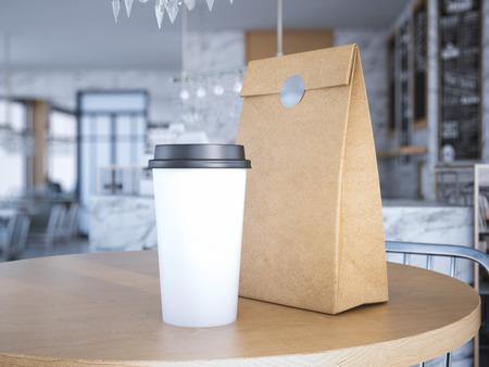 taza: Taza de Coffe y bolsa de papel sobre la mesa. Las 3D