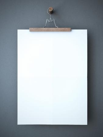 空白の紙のシートとズボン ハンガー 写真素材