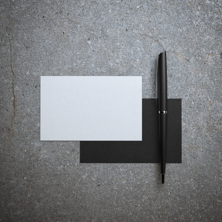 business cards: Two business cards and pen