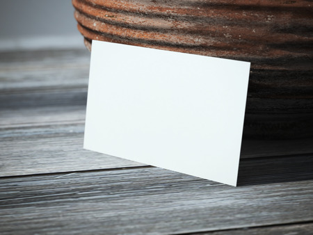 businesscard: Blank business card on the table near the vase