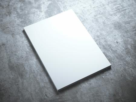 콘크리트 바닥에 흰색 빈 잡지