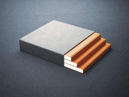 コンクリートの床に空白のボックス カバーと 3 冊の本