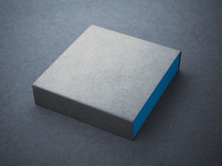 Three blue books with blank box cover on the concrete floor