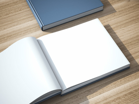 Two blank books on the wooden table