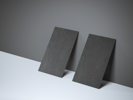 businesscard: Two black blank business cards near the wall