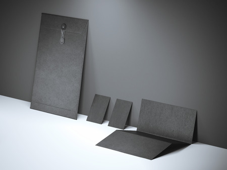 envelope: Black branding mockup near the concrete wall Stock Photo