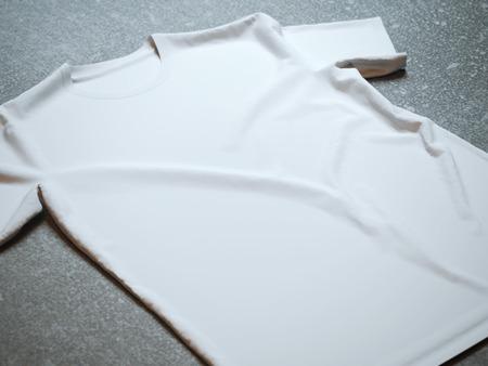 콘크리트 배경에 고립 된 흰색 셔츠 스톡 콘텐츠 - 42096321