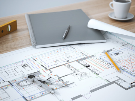 Blueprint with pencil on the wooden table