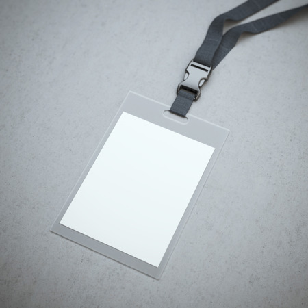 コンクリートの床に衿と空白のバッジ