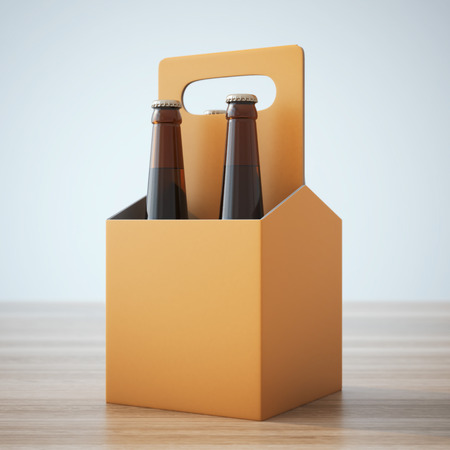 with pack: Orange beer packaging on the wooden table