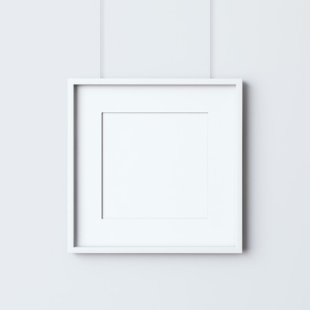 frame wall: Empty square frame hanging on the white wall