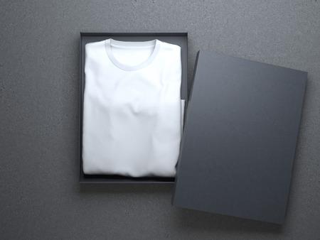 CAMISAS: Camiseta blanca en un bonito embalaje de cartón en el piso de concreto