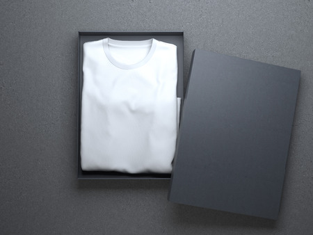 White t-shirt in a nice cardboard packaging on concrete floor