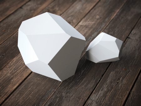 the polyhedron: Two white polyhedron on the wooden floor