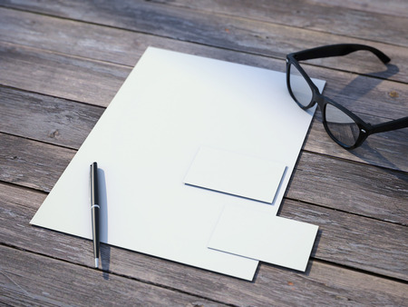 White branding mockup with black glasses on the wooden floor
