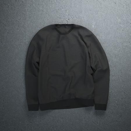 casual hooded top: Black sweatshirt on the dark concrete floor Stock Photo