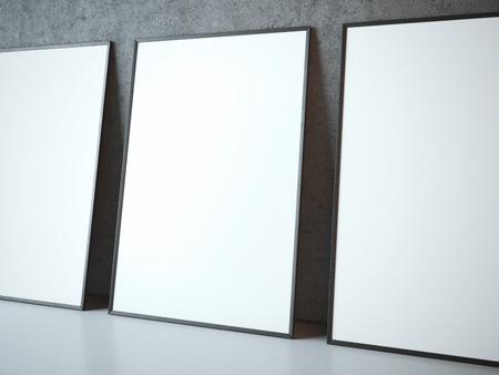 Drie lege witte kaders dichtbij concrete muur