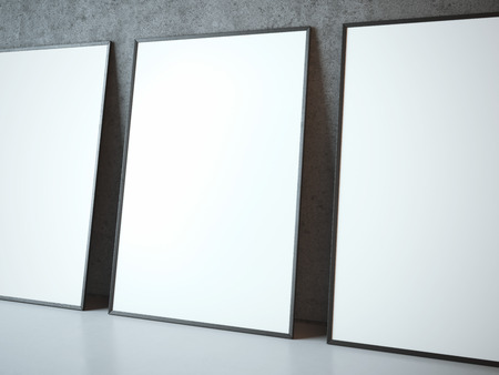 Three blank white frames near concrete wall Banco de Imagens