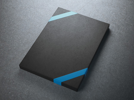 Black gift box with blue ribbon on concrete floor