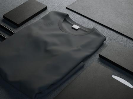 Dark mockup met lege t-shirt en visitekaartjes Stockfoto